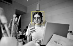 girl using a mobile facial recognition software