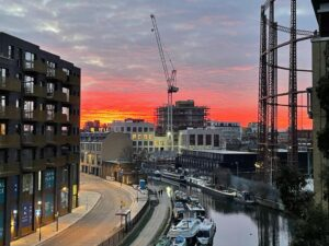 sunset over construction site in hackney london