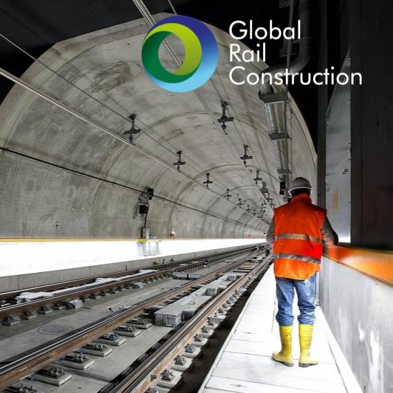 construction worker walking through a rail tunnel