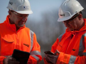network rail workers with mobile phones